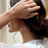 Boucles d'oreilles mariée pendante dorées et cristal